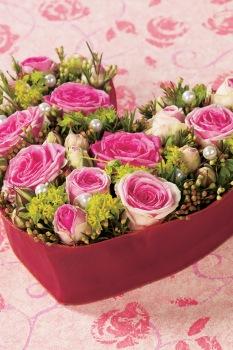Heart-shape Arrangements with Roses,Cestrum and Hypericum.