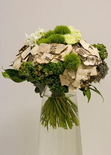 With / green bouquet with birch-wood added to it.