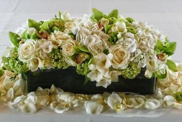 Arrangement with green cymbidium flowers.
